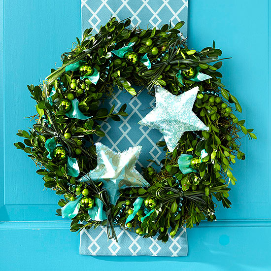 Christmas wreath with blue stars and ribbon