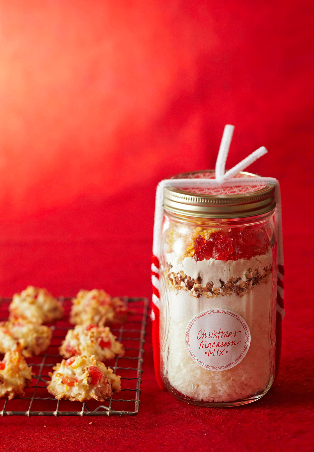Christmas Macaroon Mix in jar against red background