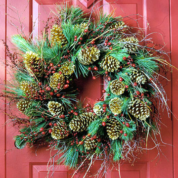 pinecone wreath on a red door