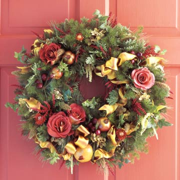 holiday wreath with apples, bows, roses, ribbons and leaves