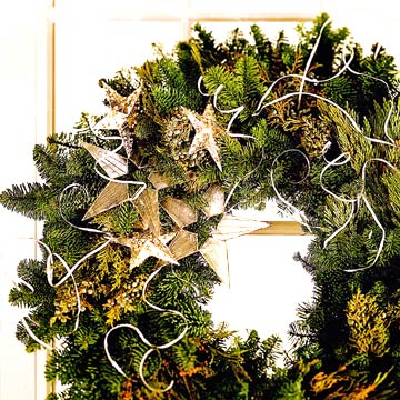 IMWreaths_Closeup Of Pine Wreath With Gold Stars and Silver Curls