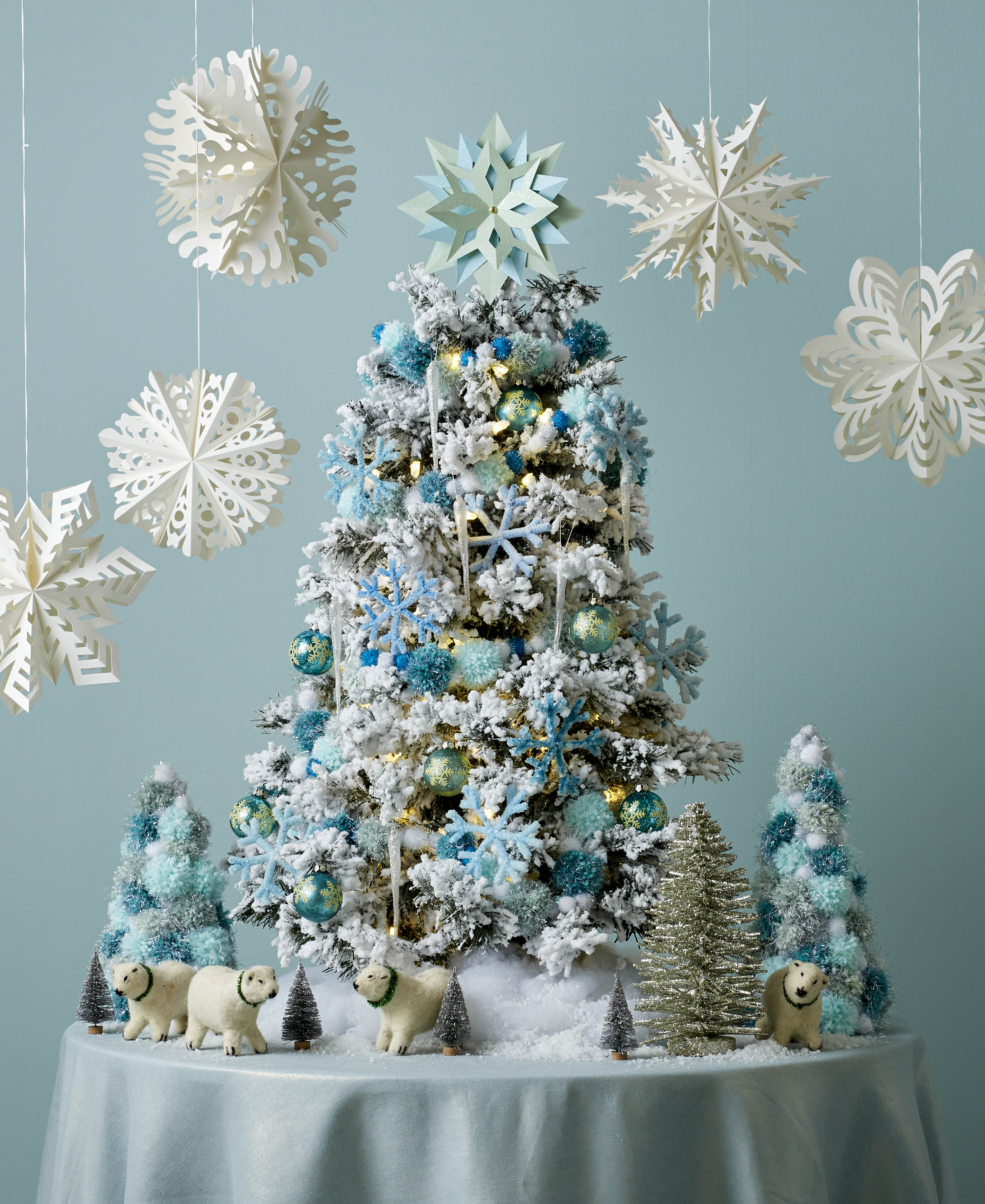 Blue and white christmas tree with paper snowflakes