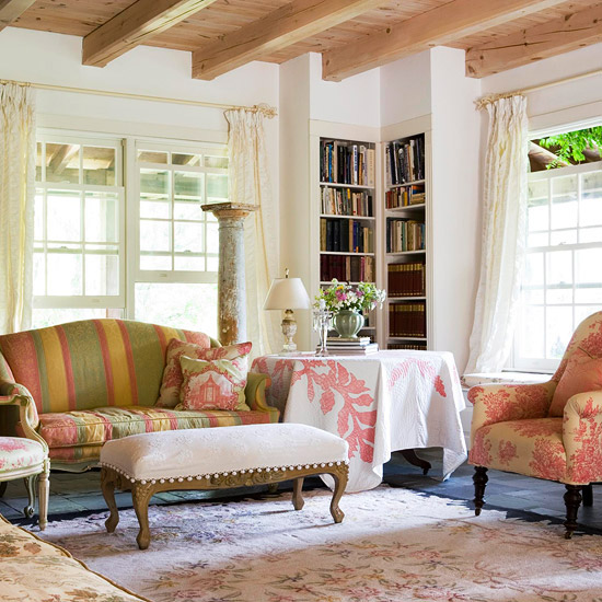 living room with pink upholstered chair