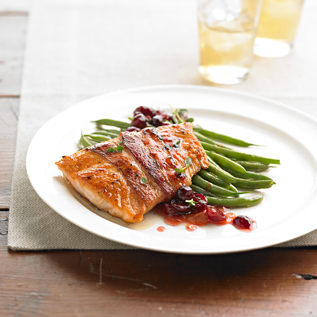 Bacon-Wrapped Salmon with Fruit Chutney on plate with green beans