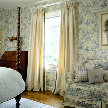 Blue and white bedroom with draperies and ribbon trim