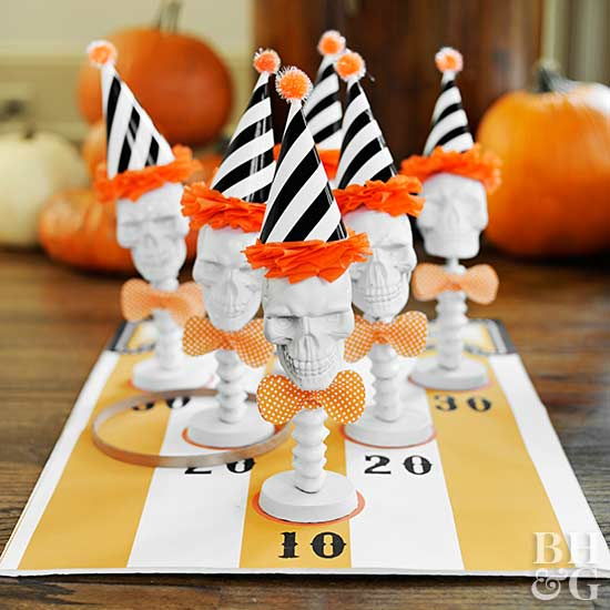 Halloween party game of white skeletons with black and white striped party hats set up at a Halloween party