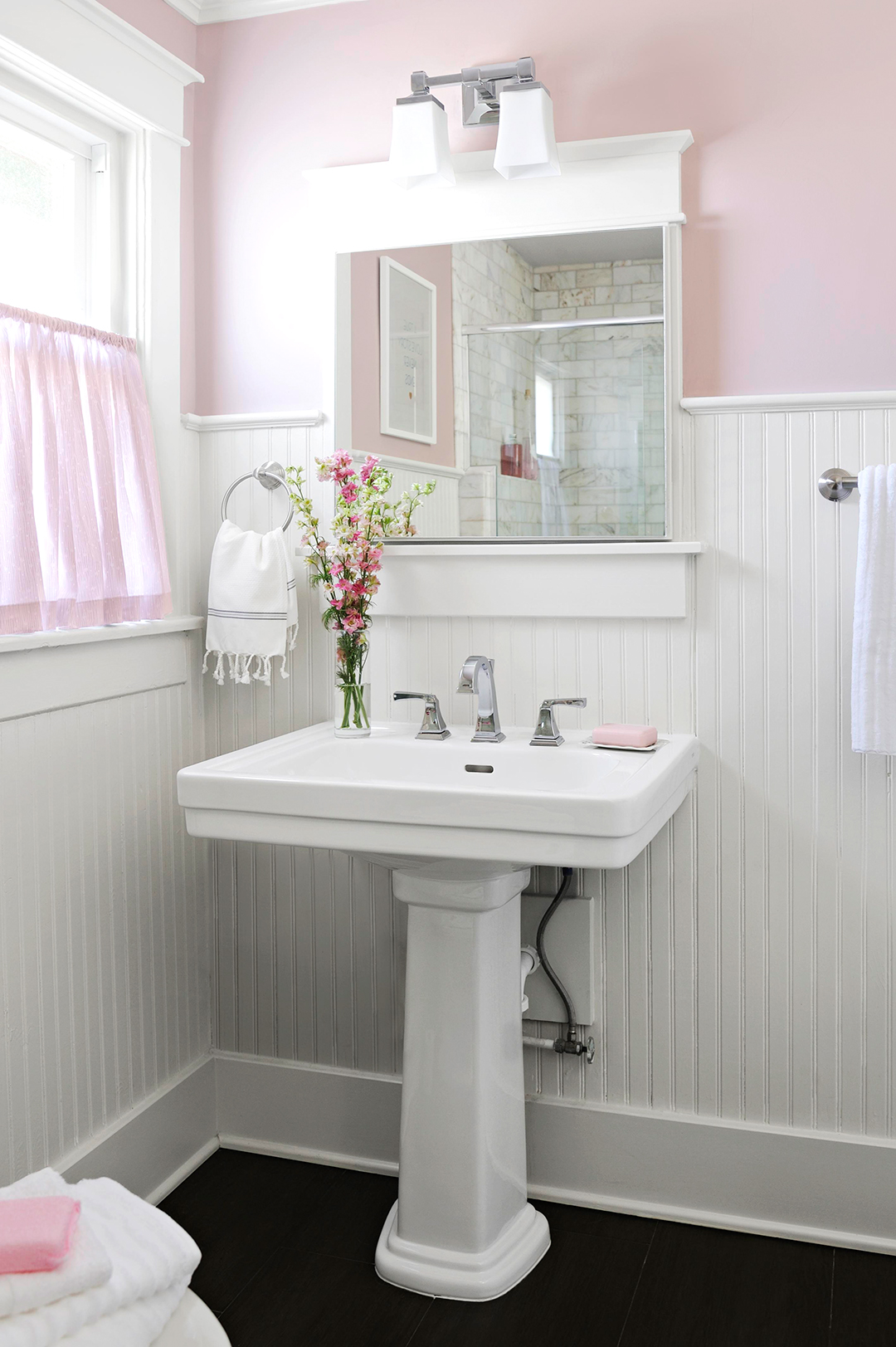 powdery pink bathroom and white lower walls and sink