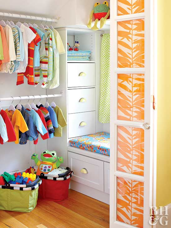 kids closet with orange panel closet door