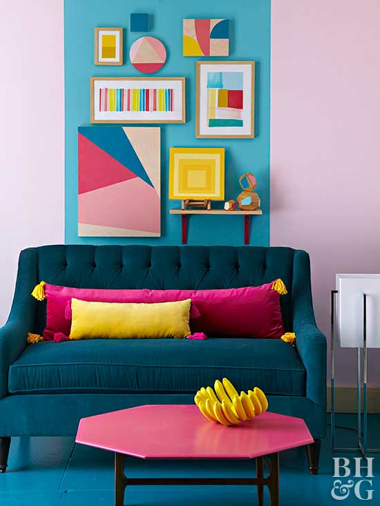 blue loveseat with bright decor