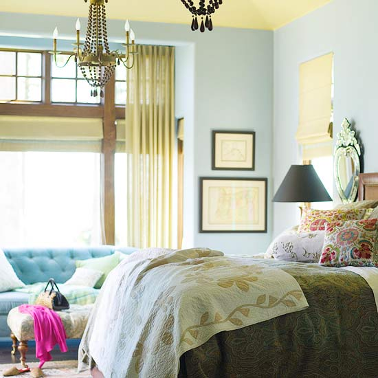 Blue bedroom with yellow accents throughout and yellow ceiling