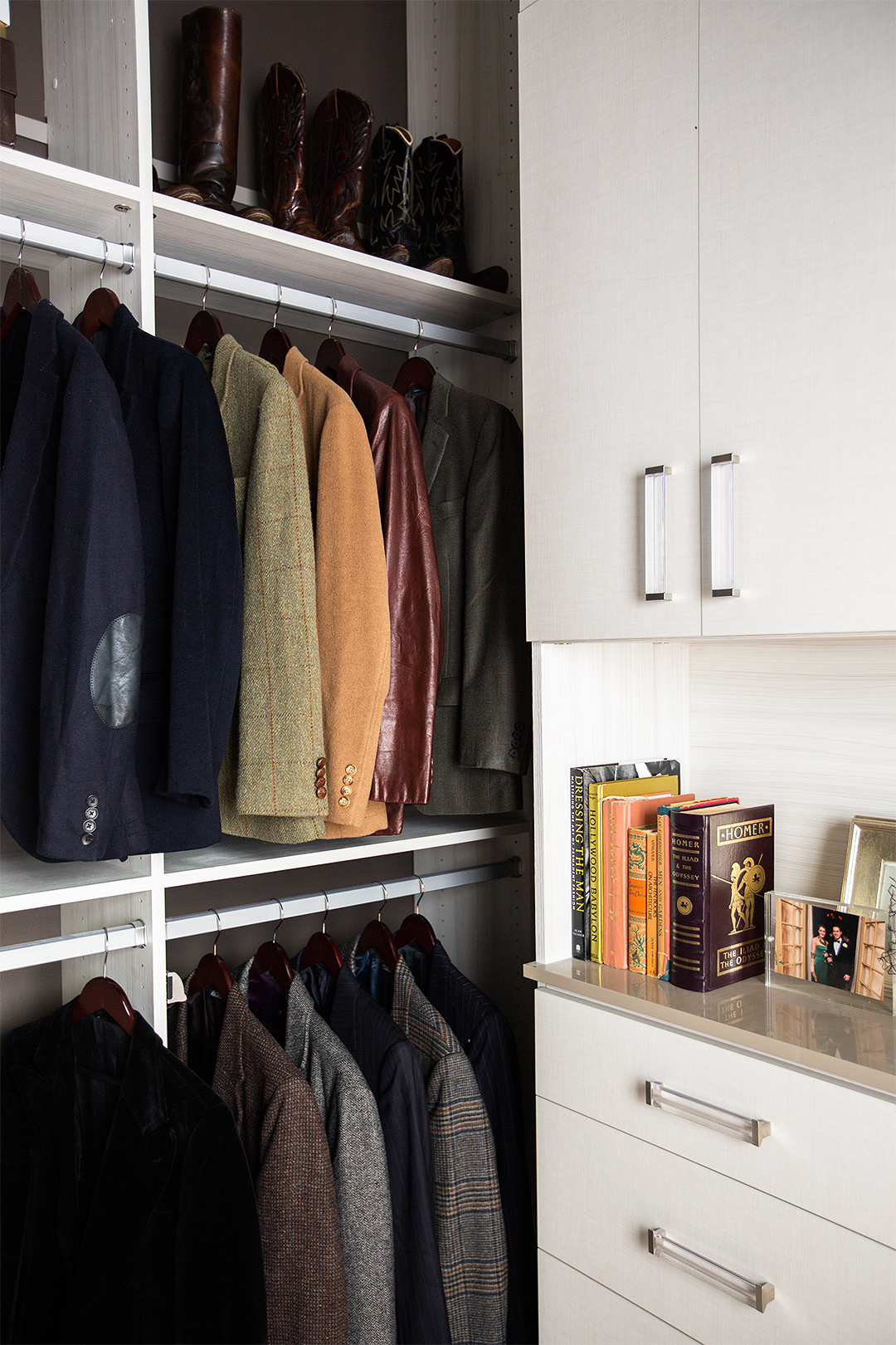 white walk in closet with menswear