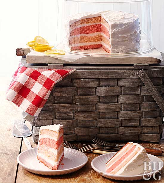 picnic basket with pink ombre cake on top