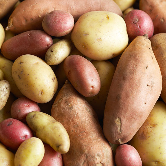collection of different types of potatoes including Russet, Red and Yukon Gold