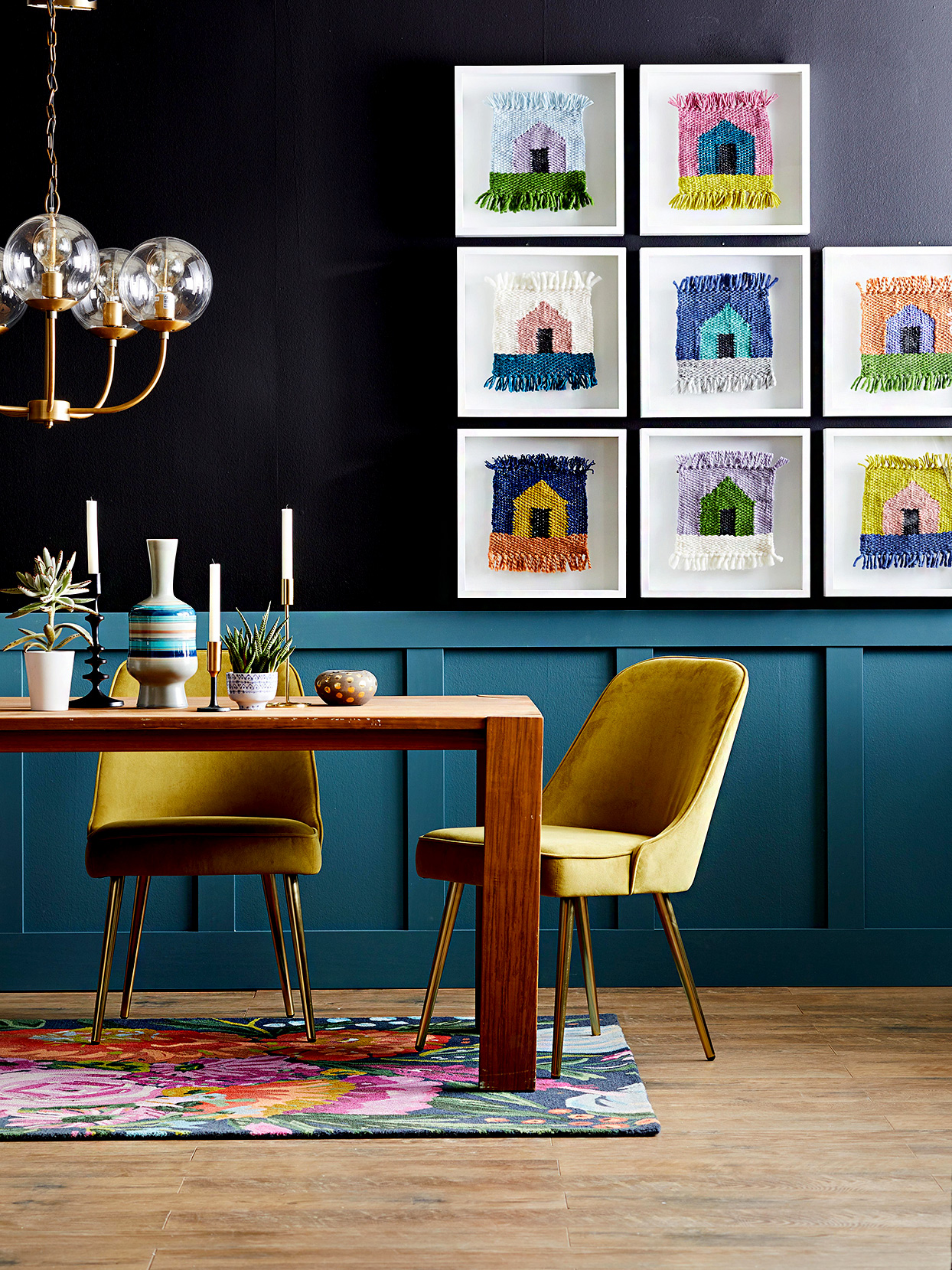 Dining room with house artwork on wall