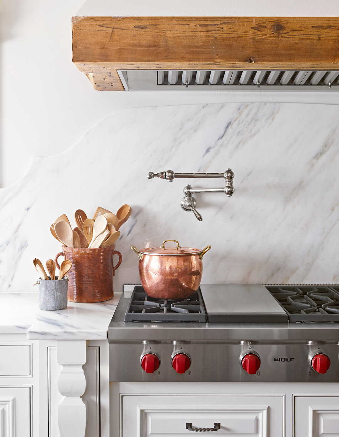 white kitchen stove range with cooking pot and utencils