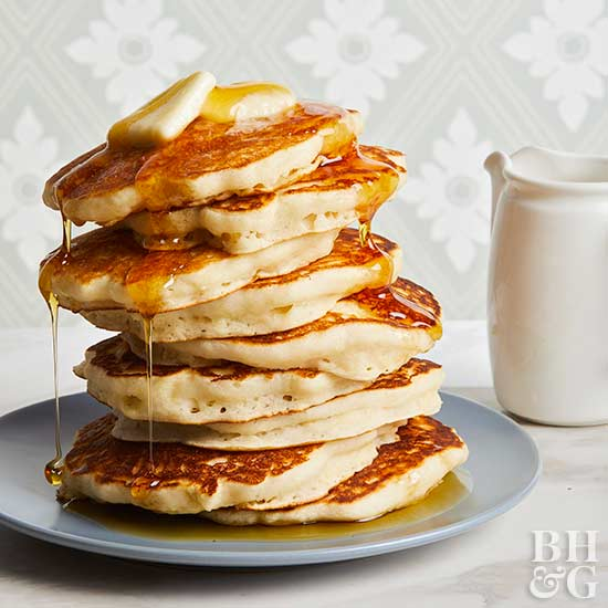 stack of Buttermilk Pancakes with syrup and butter