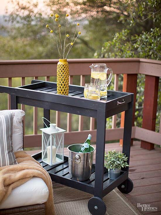 Utilize a rolling cart for double-duty deck storage and a side table surface on the go. The bottom shelf can hold potted plants, candles, or entertaining ...