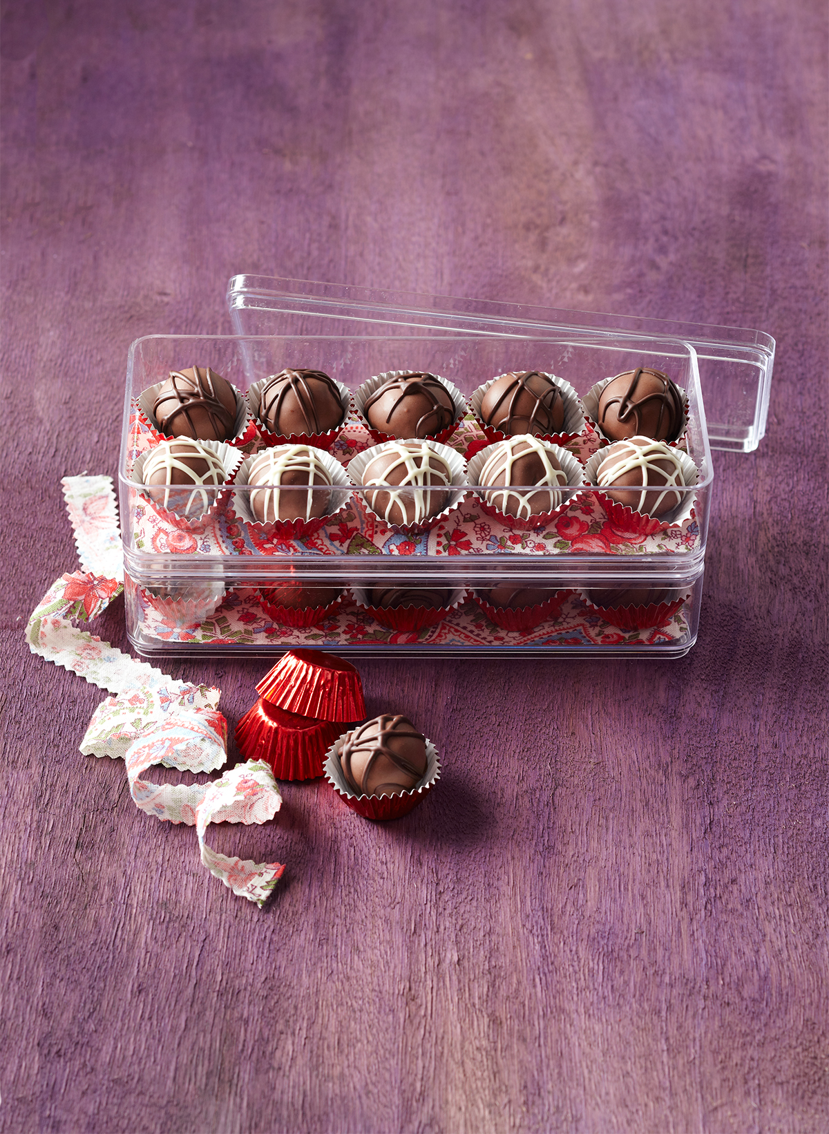 clear stackable containers with decorated truffles