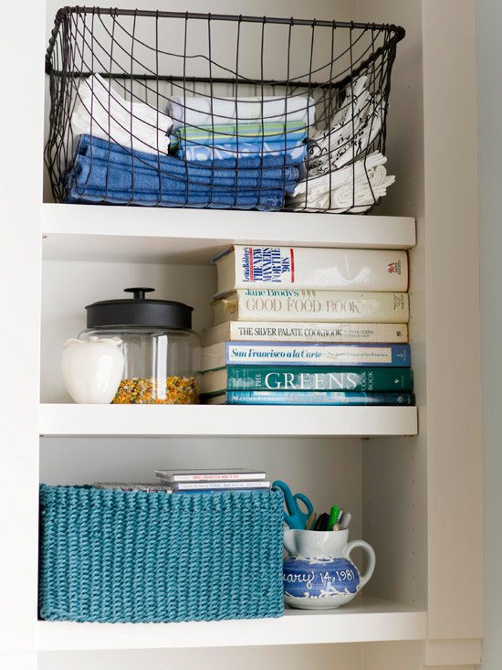 Wire basket on a shelf filled with linens