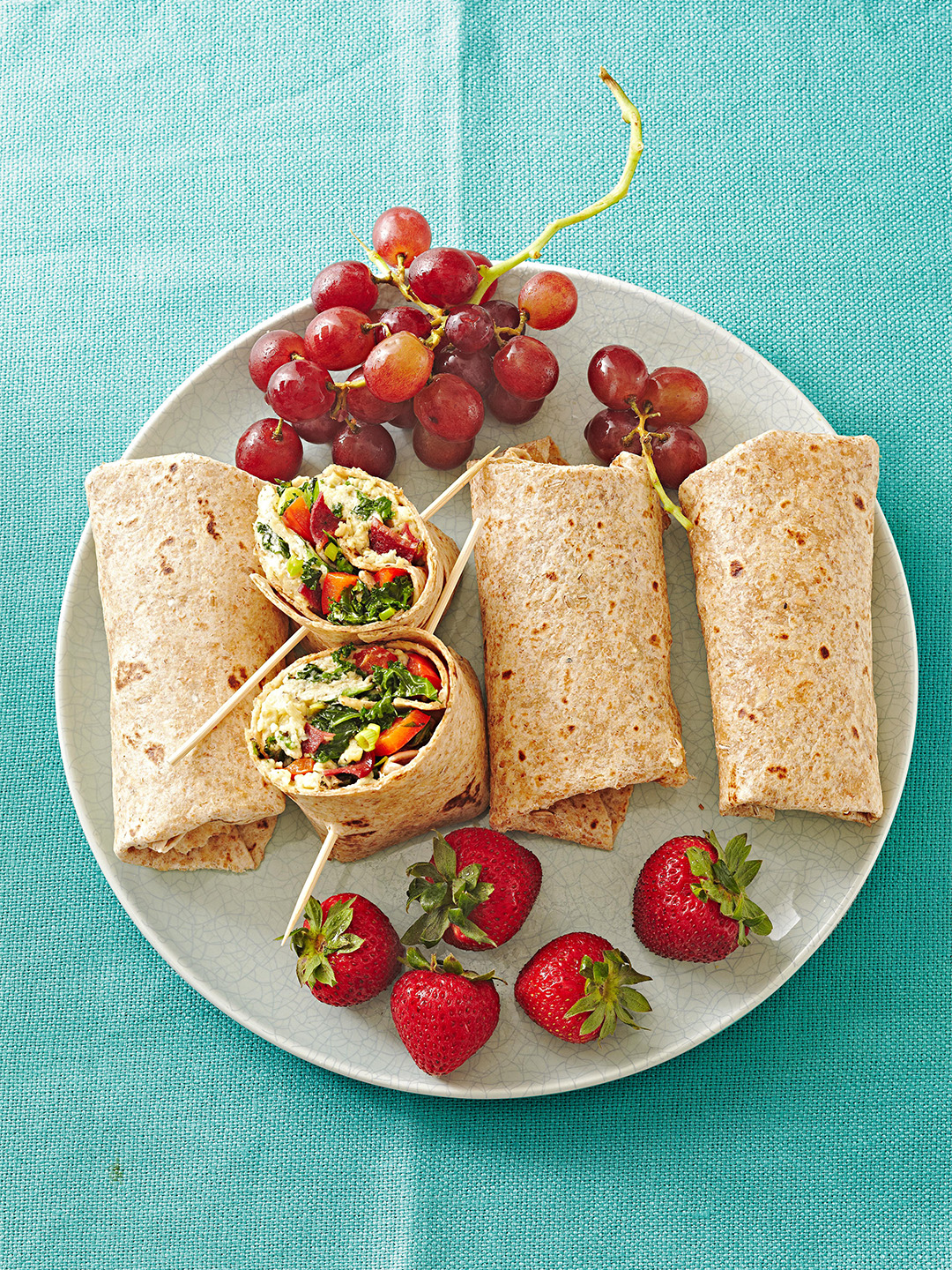 Greens-and-Bacon Omelet Wraps with grapes and strawberries