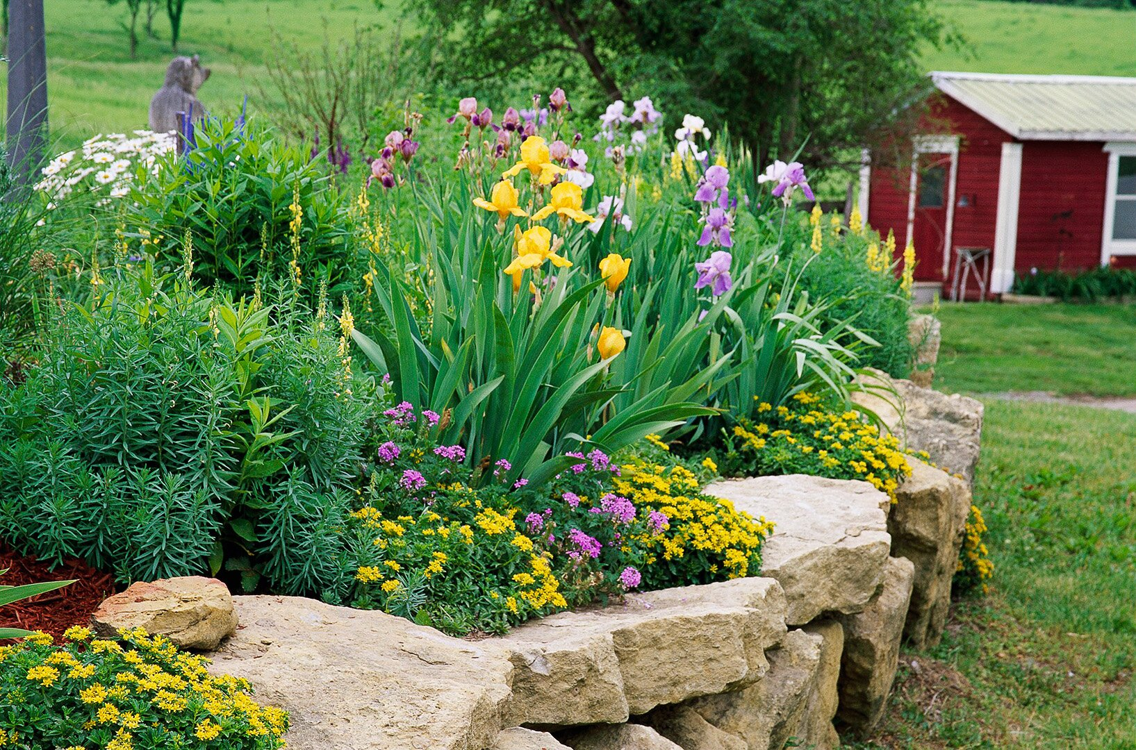 stone stack wall around raised flower bed