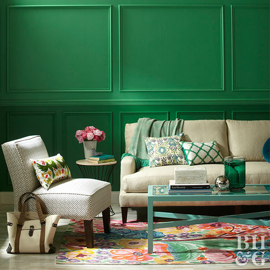 Living room with green wainscoting and neutral furniture