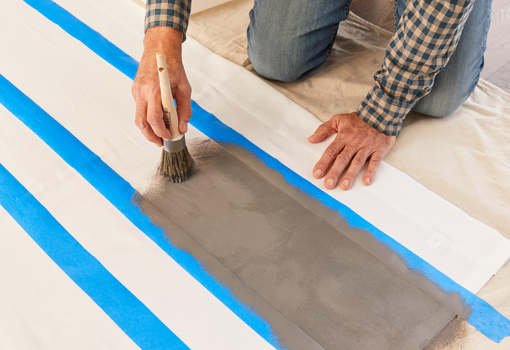 adding paint to curtain for stripe