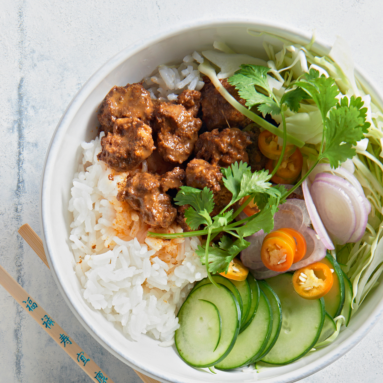 Indonesian Beef and Rice Bowl with chopsticks