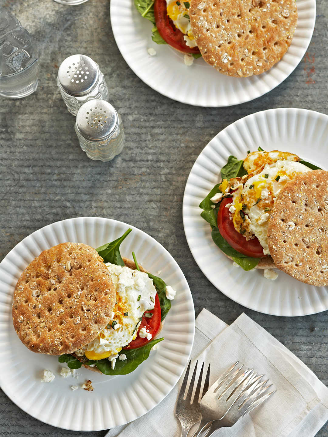 Mediterranean Breakfast Sandwiches with spinach, egg, and tomato