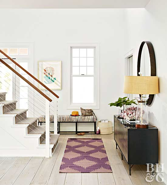 modern white entryway with arched ceilings