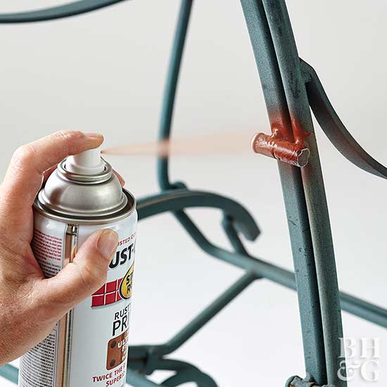 spraying rusty metal primer