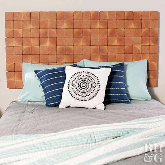 wood block headboard and blow throw pillows on the bed