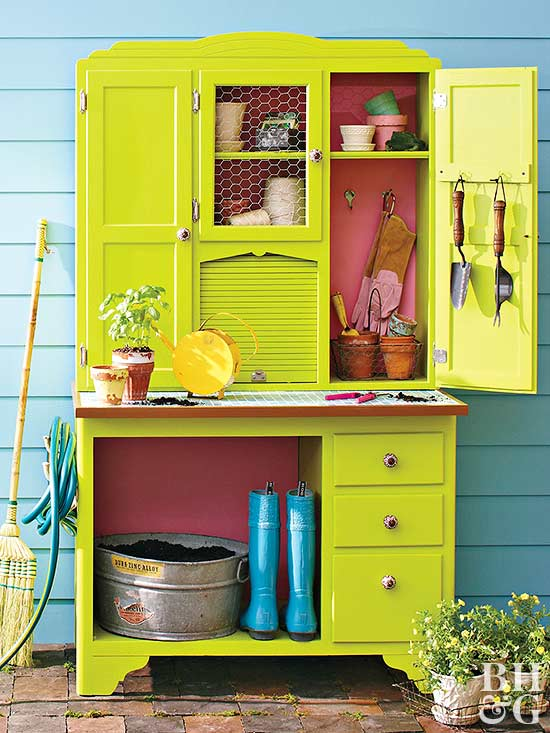 bright green China cabinet made into a garden center