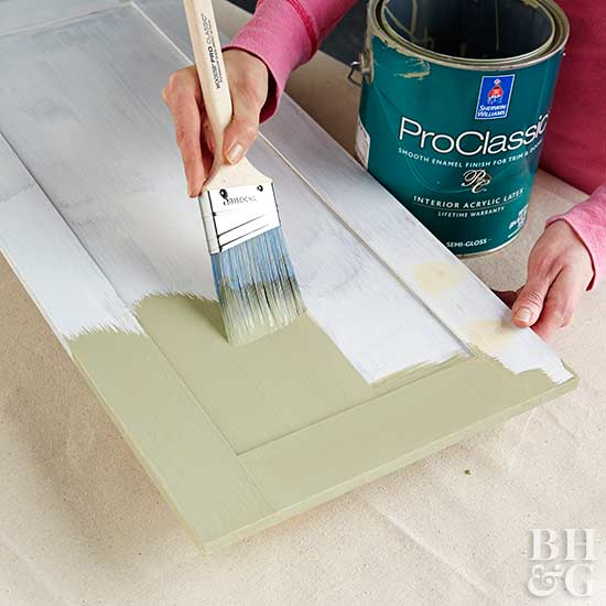painting cabinet door with green paint