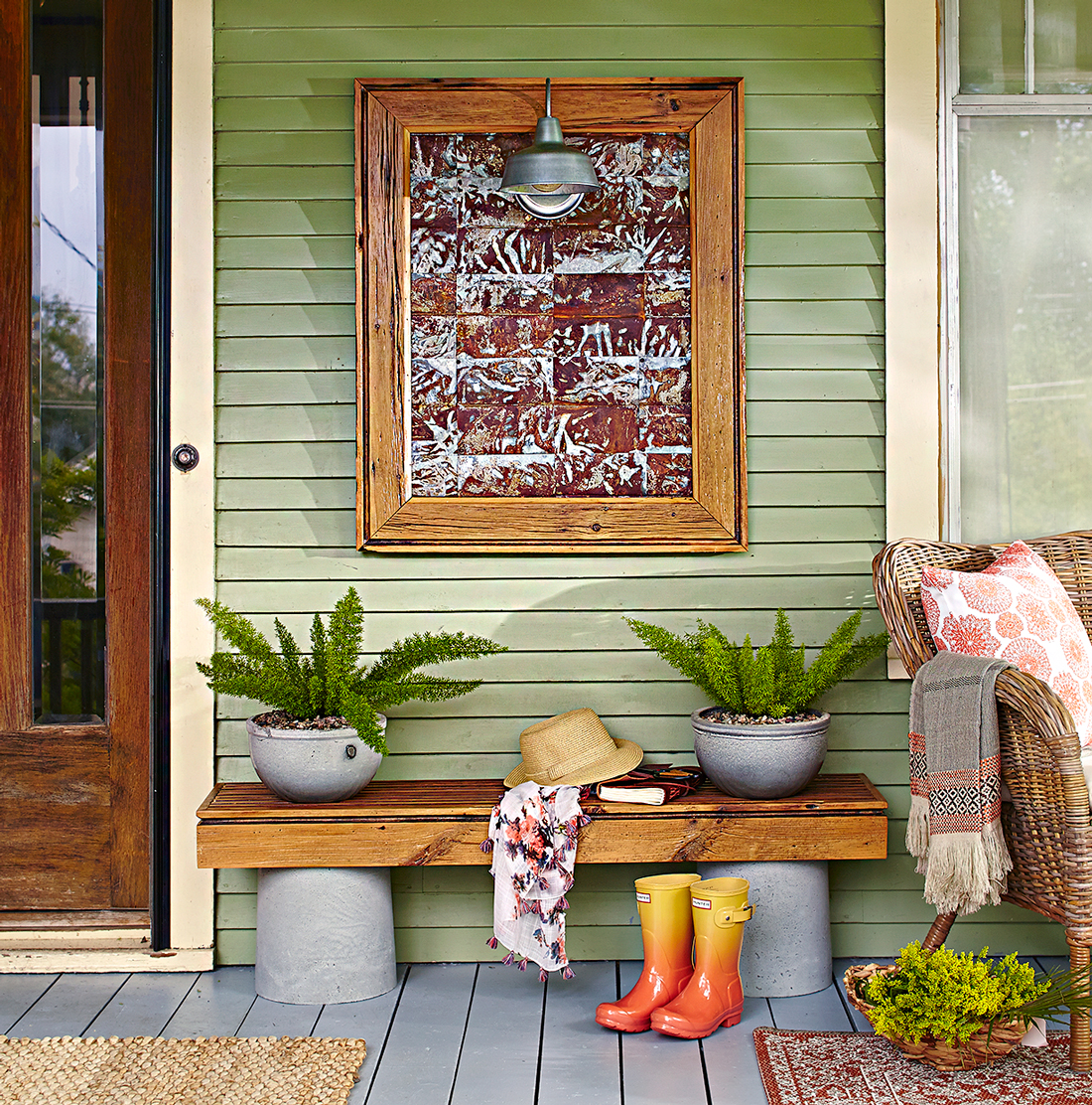 metal wall art and reclaimed wood bench on porch