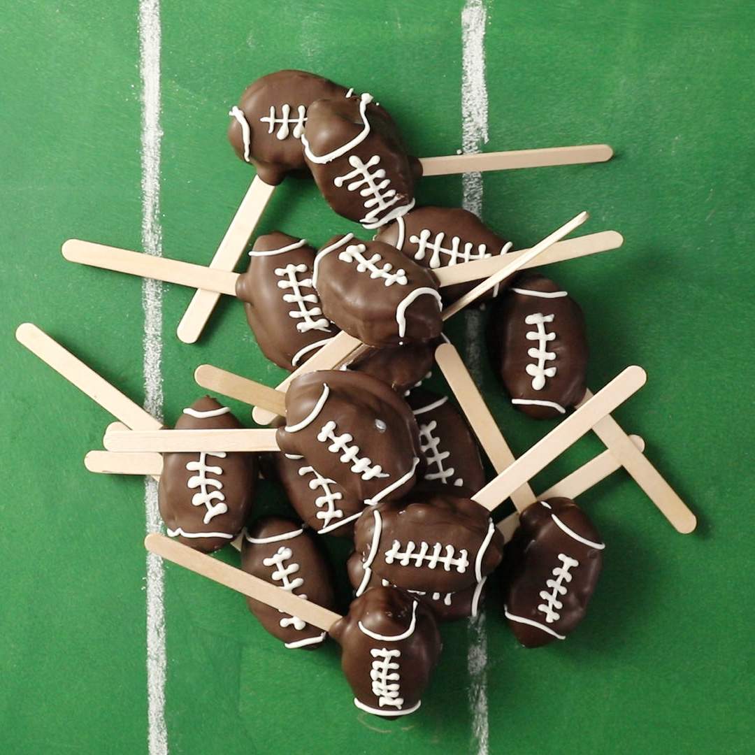 bunch of football cookie dough pops