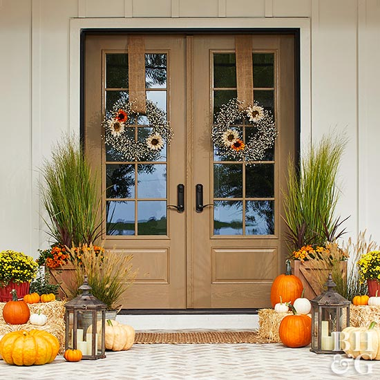 fall front door with pumpkins and hay bales