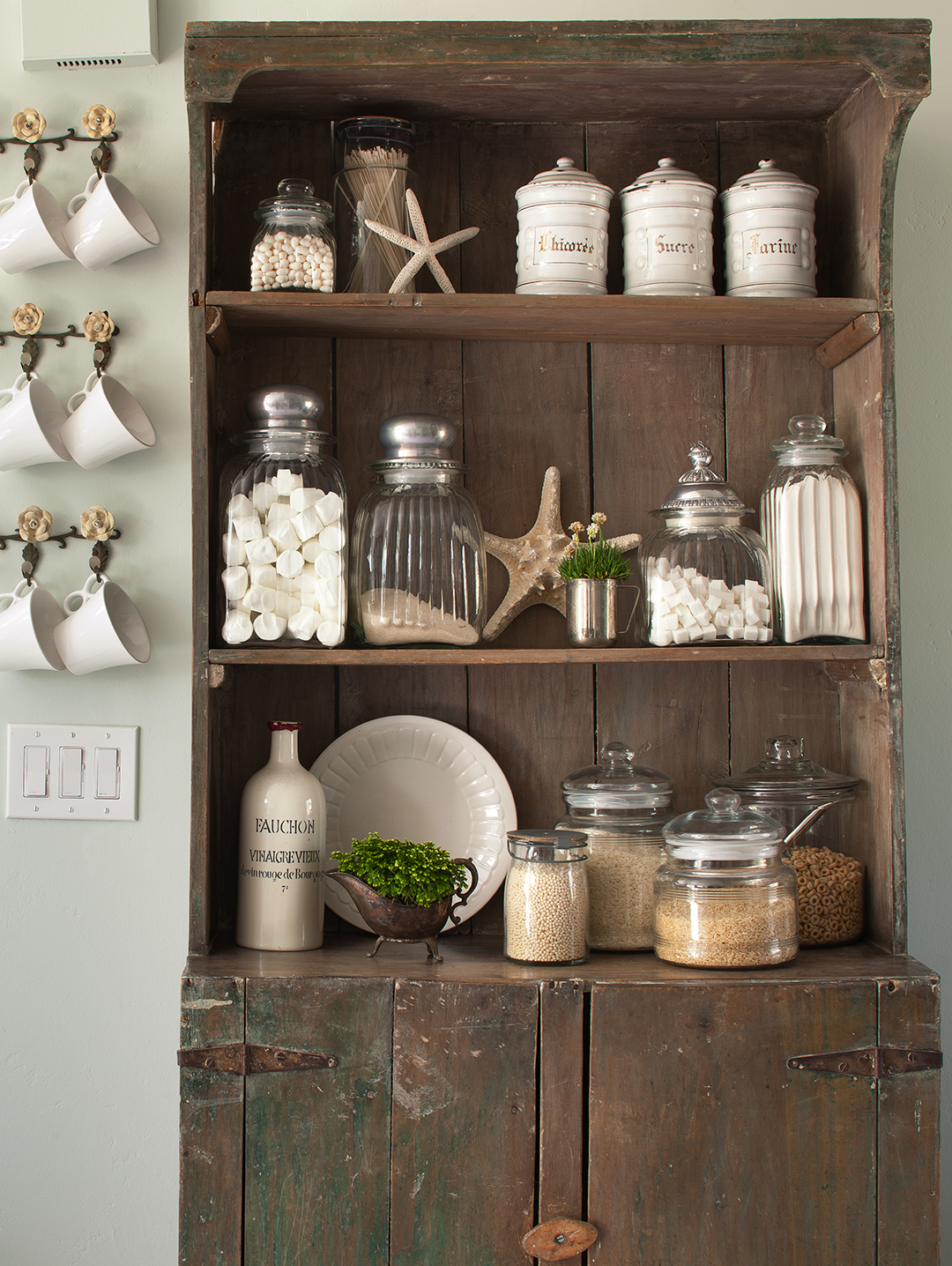 hutch with jars and containers