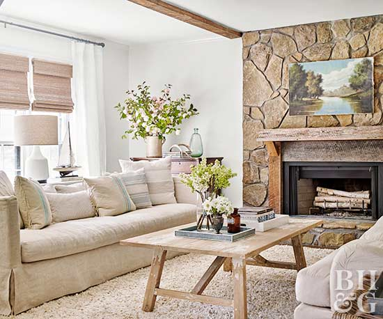 neutral living area with stone fireplace