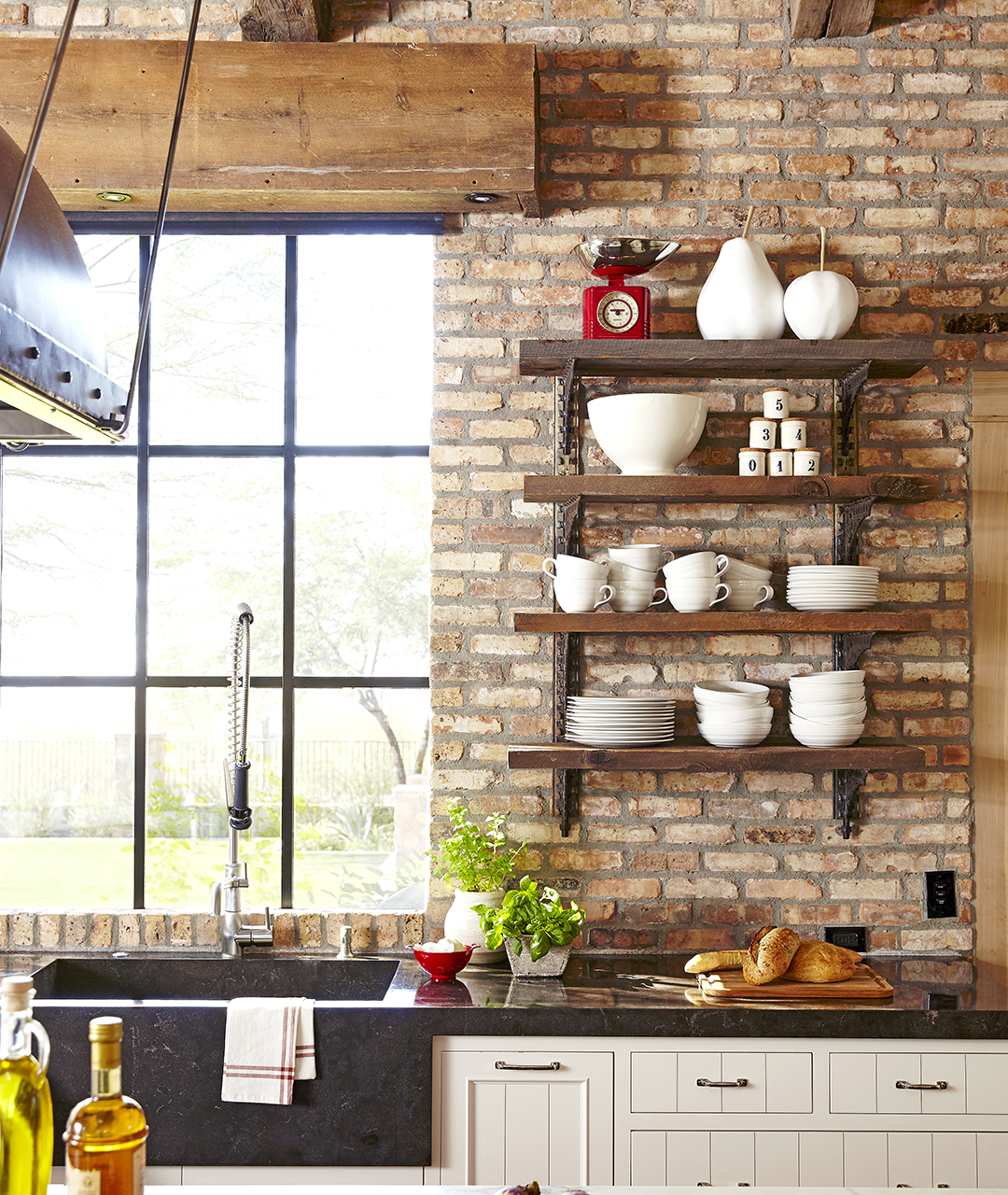 open kitchen with wood accents and brick walls