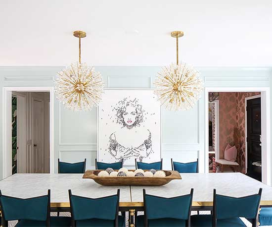 blue chairs at dining room table with Marilyn Monroe art