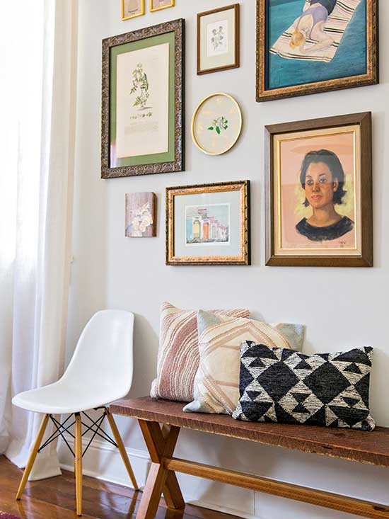 bench and eclectic gallery wall