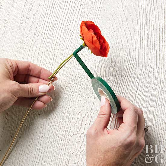 wrapping floral tape around stem