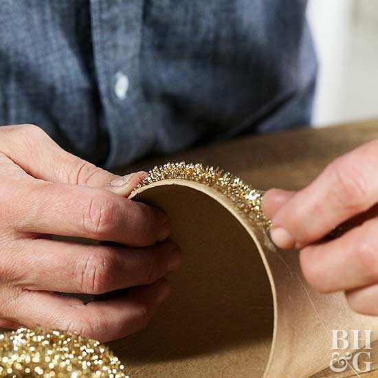 wrapping gold tinsel to paper cone