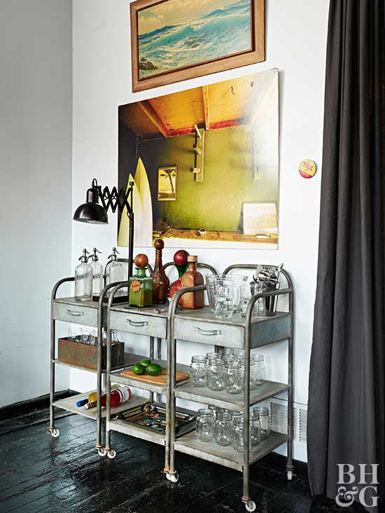 rustic bar cart with colorful artwork hanging above