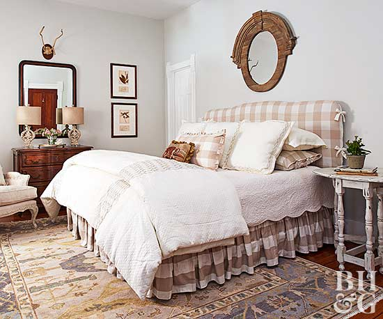 bedroom with beige gingham headboard and bed skirt