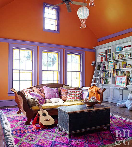 living room with orange walls and purple painted trim accents