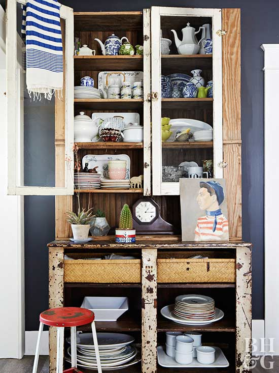rustic cabinet filled with dinnerware and serving pieces