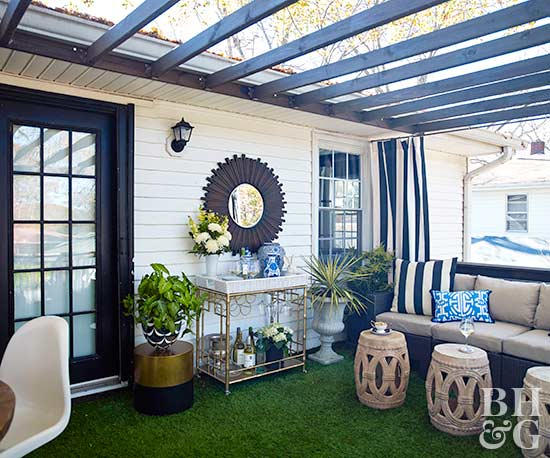 outdoor seating area with artificial turf
