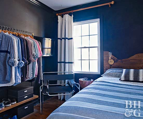 blue bedroom with clothes hanging solution